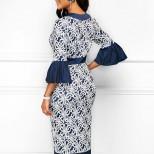 Тъмносиня рокля с бели детайли