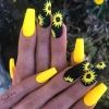 жълти нокти със слънчогледи.jpg