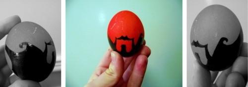 Червено великденско яйце с черна рисунка