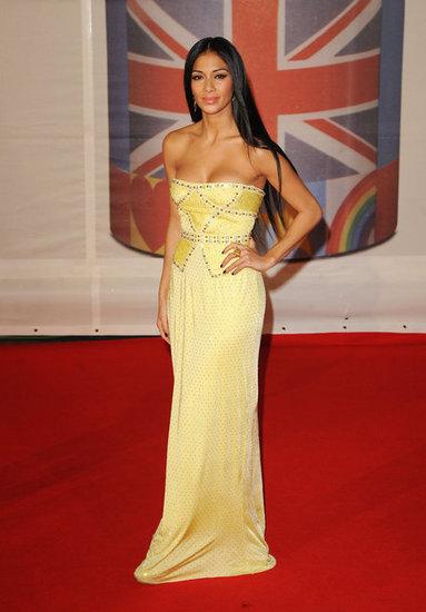 Никол Шерцингер в жълта рокля Versace