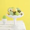 Едноцветни яйца в нежни нюанси жълто и зелено за Великден