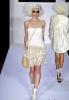 Снежно бяла рокля без презрамки с пола от дантела Bebe пролет 2012
