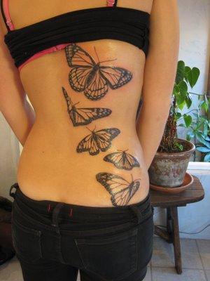 Татуировка големи пеперуди на целия гръб