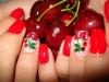 Красив червен маникюр с декорация череши