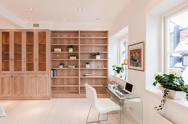 Двуетажен апартамент в Стокхолм - библиотека