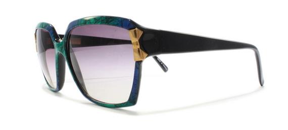 Елегантни слънчеви очила от Нина Ричи 2013